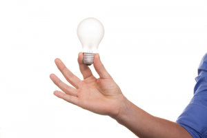 Man holding a lightbulb